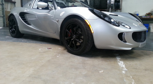 David Came In and wanted his Lotus To have a more custom look so we repaired and powdercoated his rims with a High Gloss black  Here the final Product